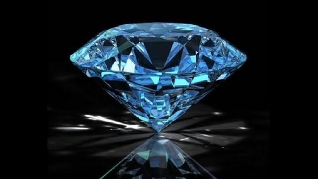Un diamant albastru vândut pentru 32,6 milioane de dolari, record mondial