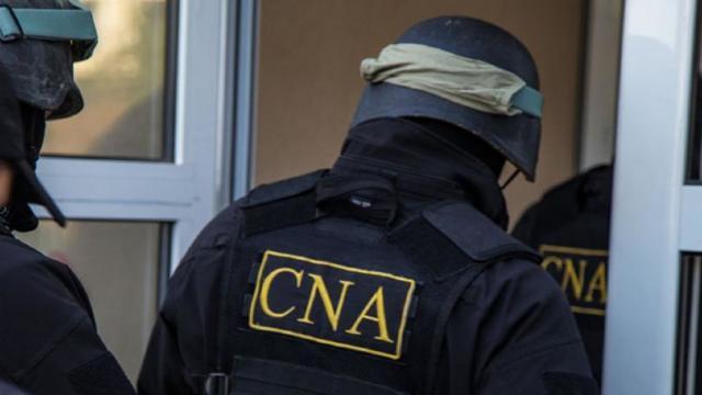 Patru persoane au fost reținute în urma perchezițiilor de la Guvern și Ministerul Justiției