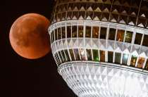 Great juxtaposition from this photographer of the moon appearing to collide with the Berlin TV Tower, Germany. Photograph: Clemens Bilan/EPA