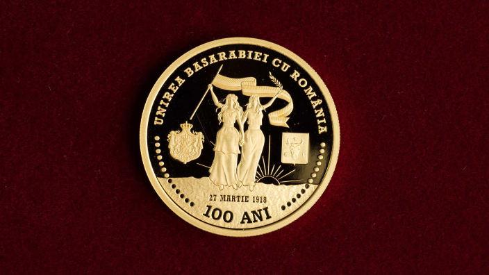 AUR pentru Centenar   În cinstea Unirii, Banca Centrală de la Chișinău a emis o monedă comemorativă în 2018