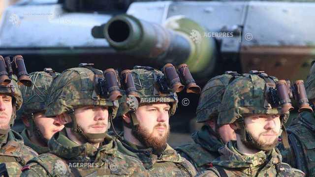 Germania a promis NATO că va crește cheltuielile în domeniul apărării