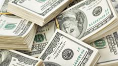 Zeci de milionari cer taxarea suplimentară