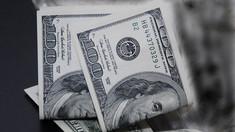 În următoarele zile, dolarul american va depăși pragul de 18 lei