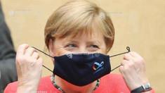 Angela Merkel își face prima apariție publică purtând mască, pentru a aplana criticile