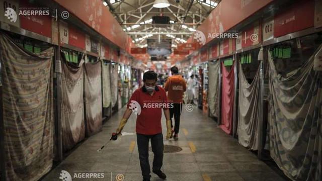 China va închide treptat toate piețele unde se comercializează păsări vii