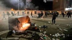 Coronavirus: Ciocniri între manifestanți împotriva restricțiilor și poliție în Spania și Italia