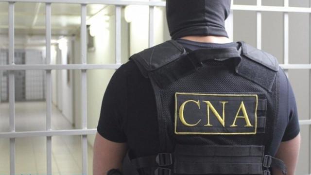 Doi polițiști, cercetați de CNA pentru trafic de influență